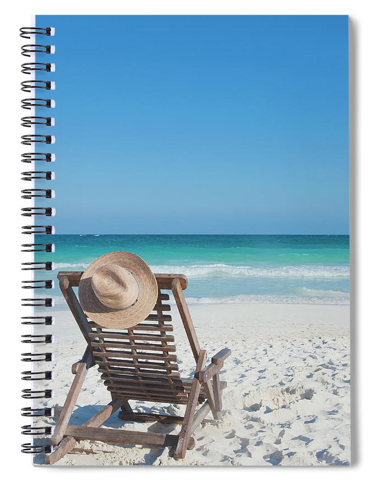 Scenics Spiral Notebook featuring the photograph Beach Chair With A Hat On An Empty Beach by Sasha Weleber