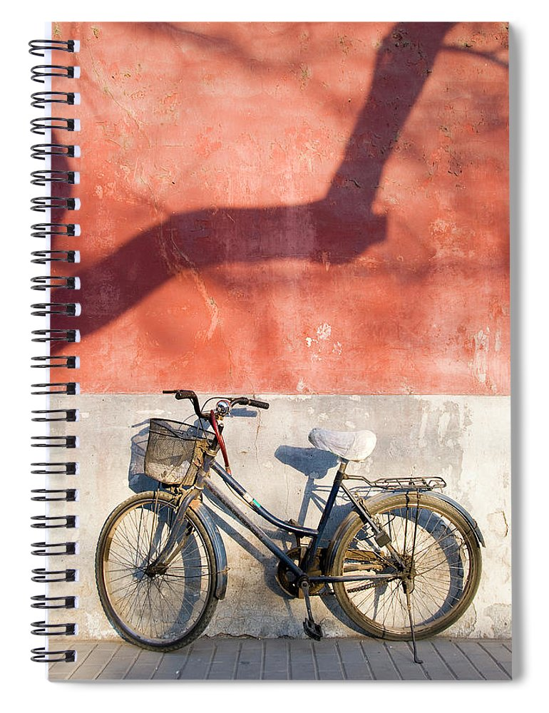 Chinese Culture Spiral Notebook featuring the photograph Bicycle Against Red Wall by Frankvandenbergh