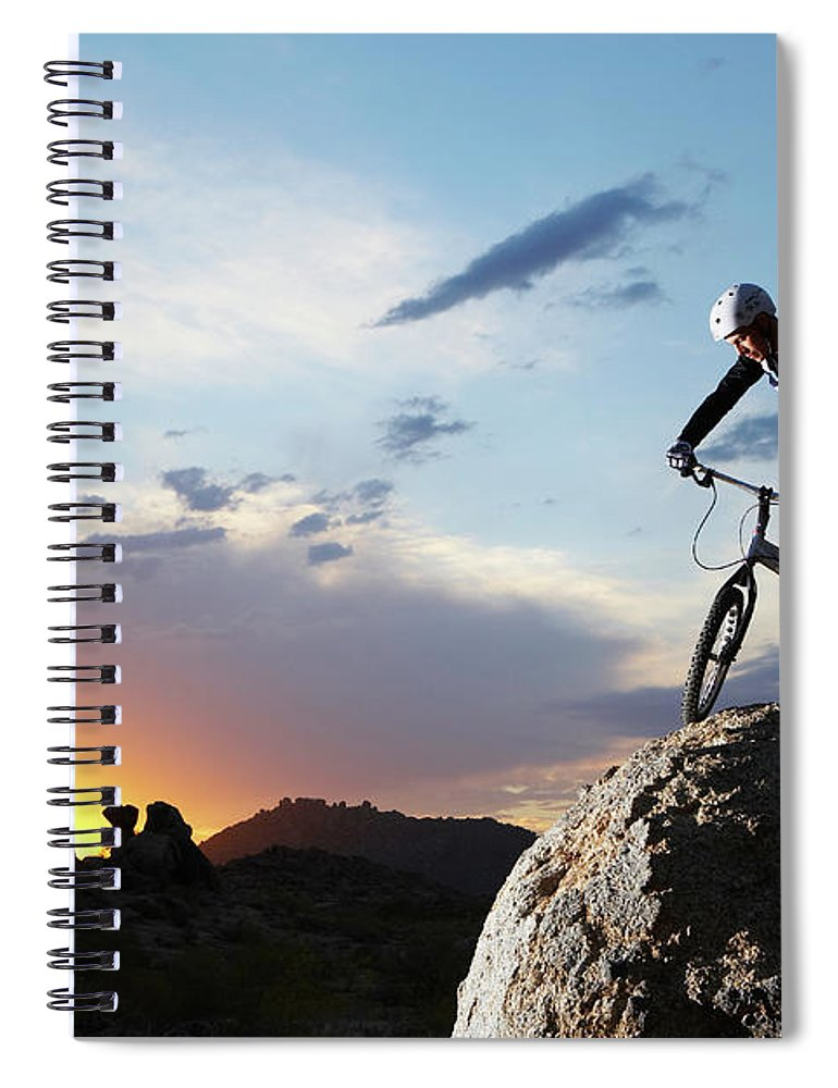 Sports Helmet Spiral Notebook featuring the photograph Bike Rider Balancing On Rock Boulder by Thomas Northcut