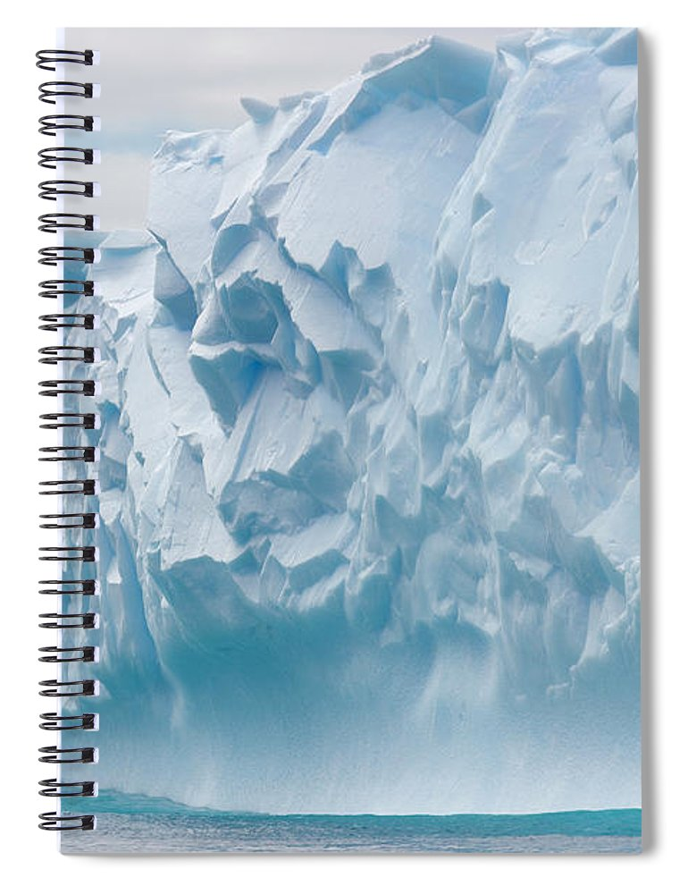 Scenics Spiral Notebook featuring the photograph Blue Iceberg Carved By Waves Floats In by Eastcott Momatiuk