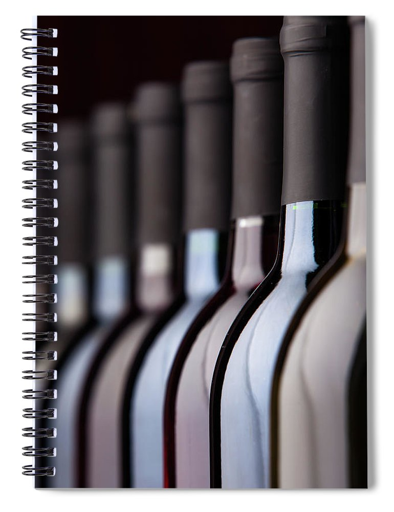 Alcohol Spiral Notebook featuring the photograph Bottles Of Wine In A Row by Halbergman