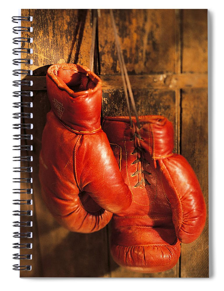 Hanging Spiral Notebook featuring the photograph Boxing Gloves Hanging On Rustic Wooden by Comstock