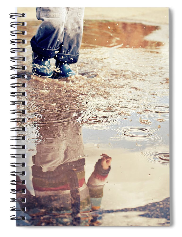 Toddler Spiral Notebook featuring the photograph Child In A Puddle by Vpopovic