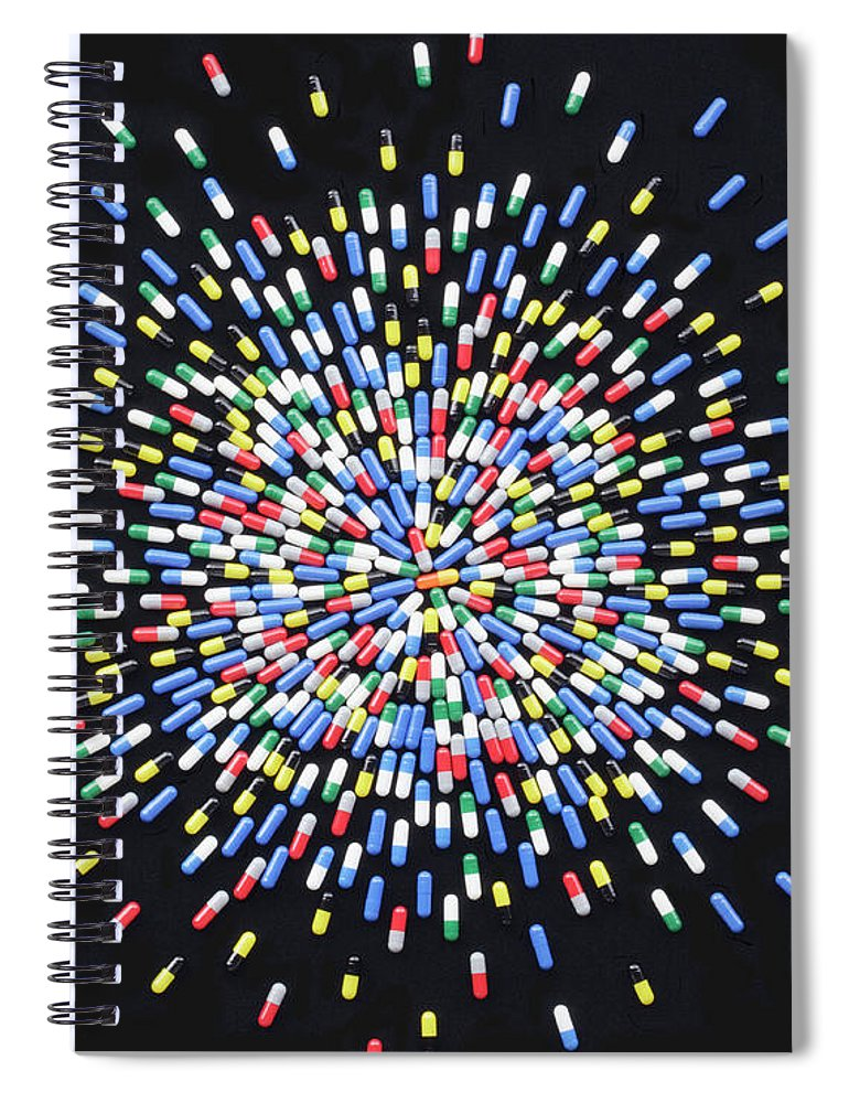 Social Issues Spiral Notebook featuring the photograph Coloured Medicine Capsules Arranged In by Paul Taylor
