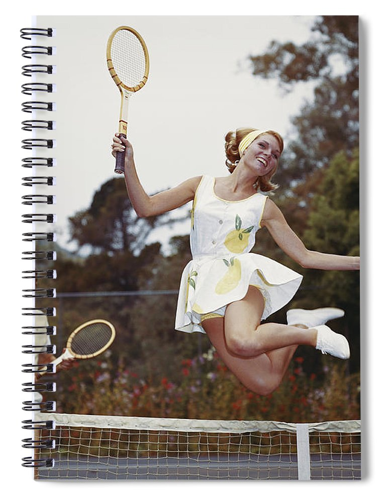 Heterosexual Couple Spiral Notebook featuring the photograph Couple On Tennis Court, Woman Jumping by Tom Kelley Archive