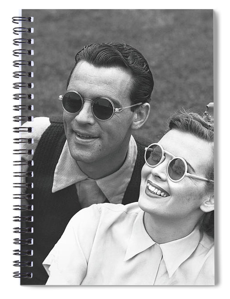 Young Men Spiral Notebook featuring the photograph Couple Wearing Sunglasses Sitting On by George Marks