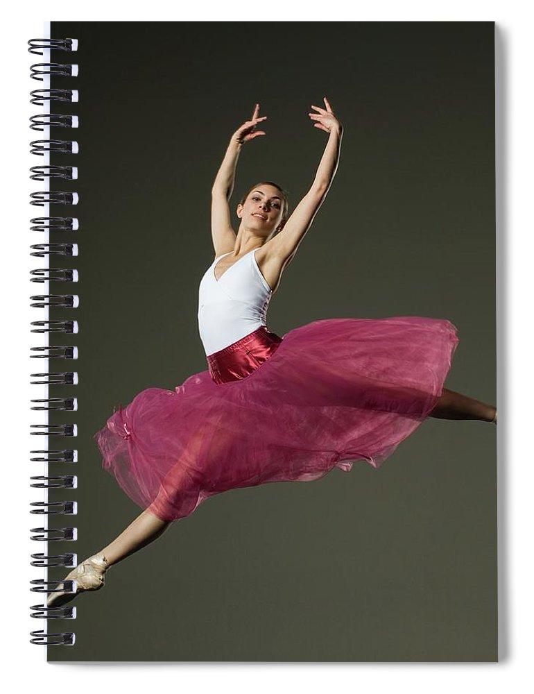 Ballet Dancer Spiral Notebook featuring the photograph Female Ballet Dancer Jumping by Tetra Images - Erik Isakson