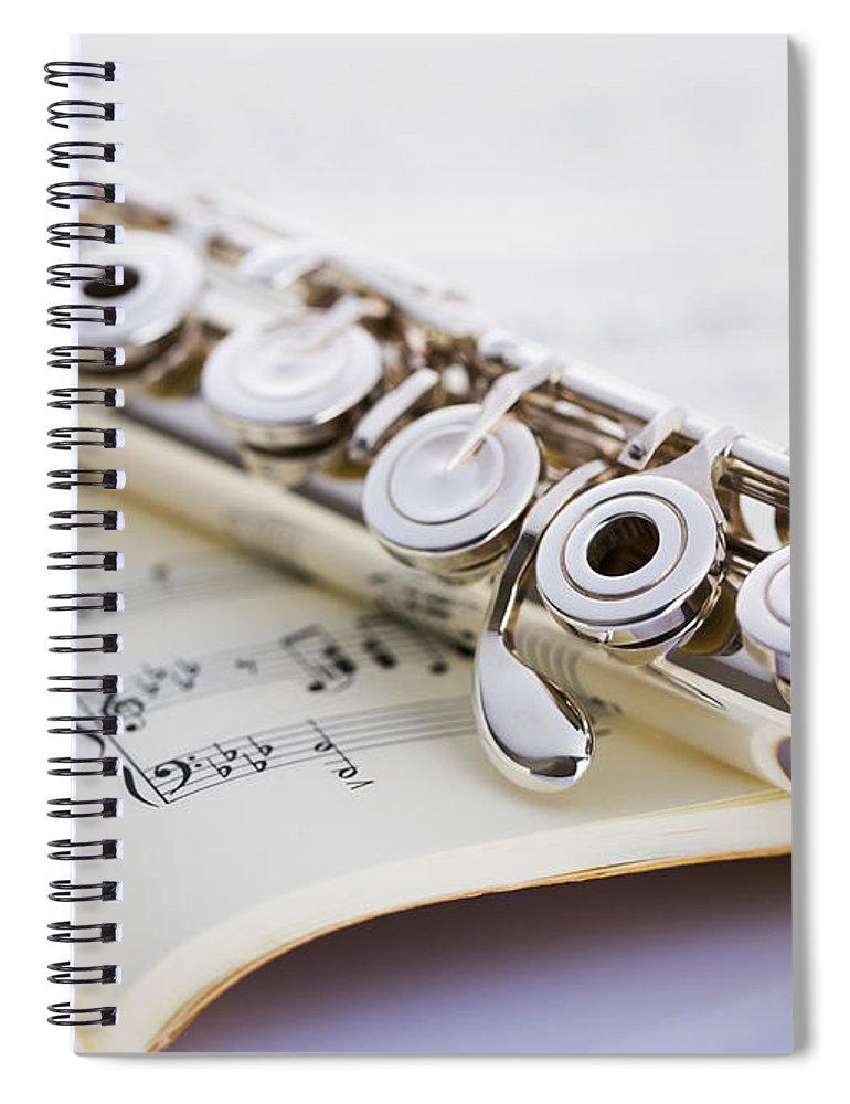 Sheet Music Spiral Notebook featuring the photograph Flute On A Score by Imagenavi