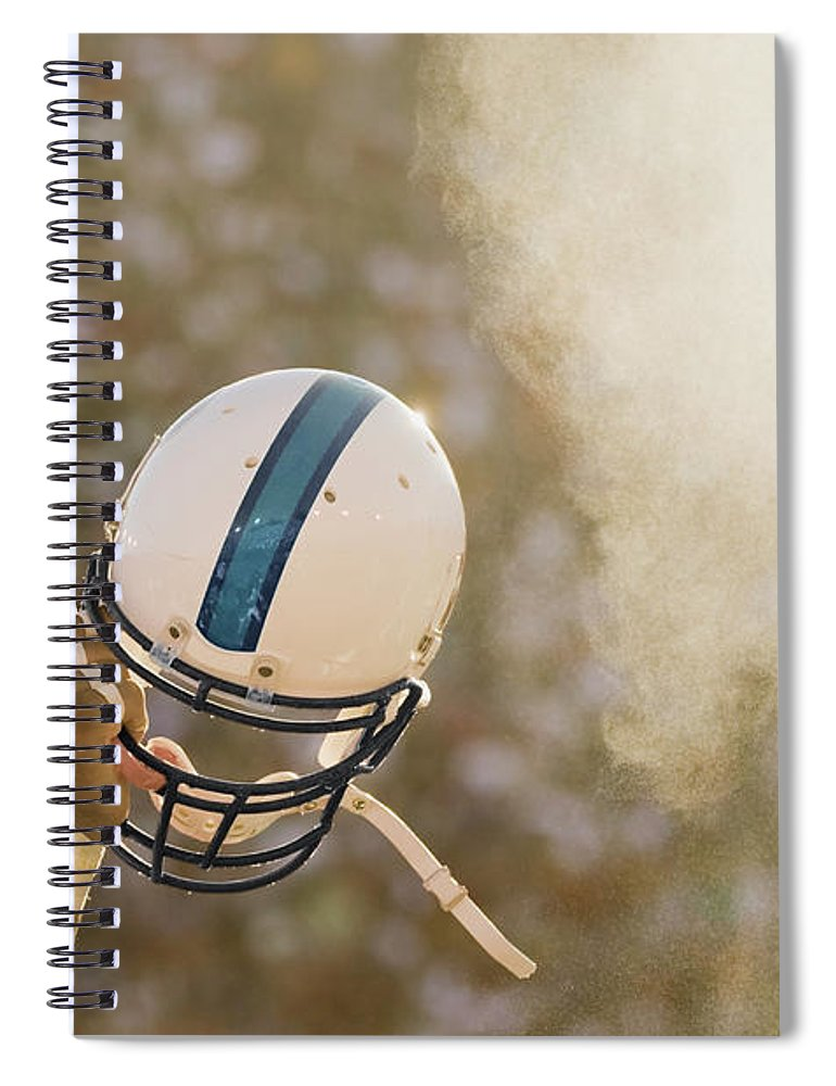 Celebration Spiral Notebook featuring the photograph Football Player Waving Helmet In Air by David Madison