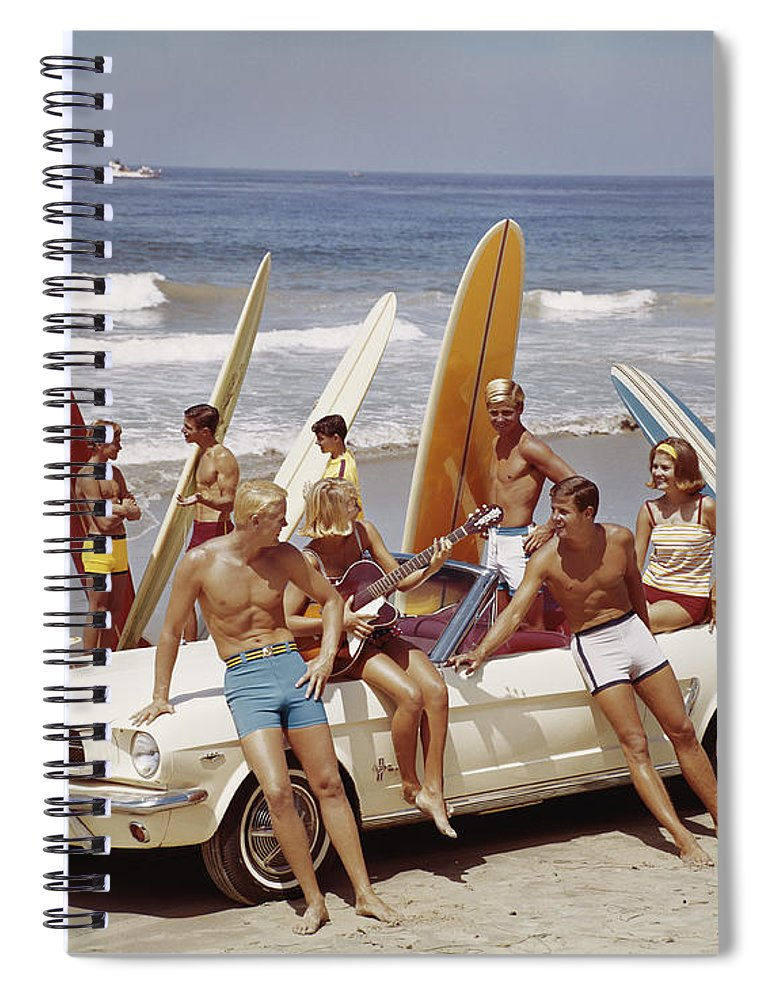 Young Men Spiral Notebook featuring the photograph Friends Having Fun On Beach by Tom Kelley Archive