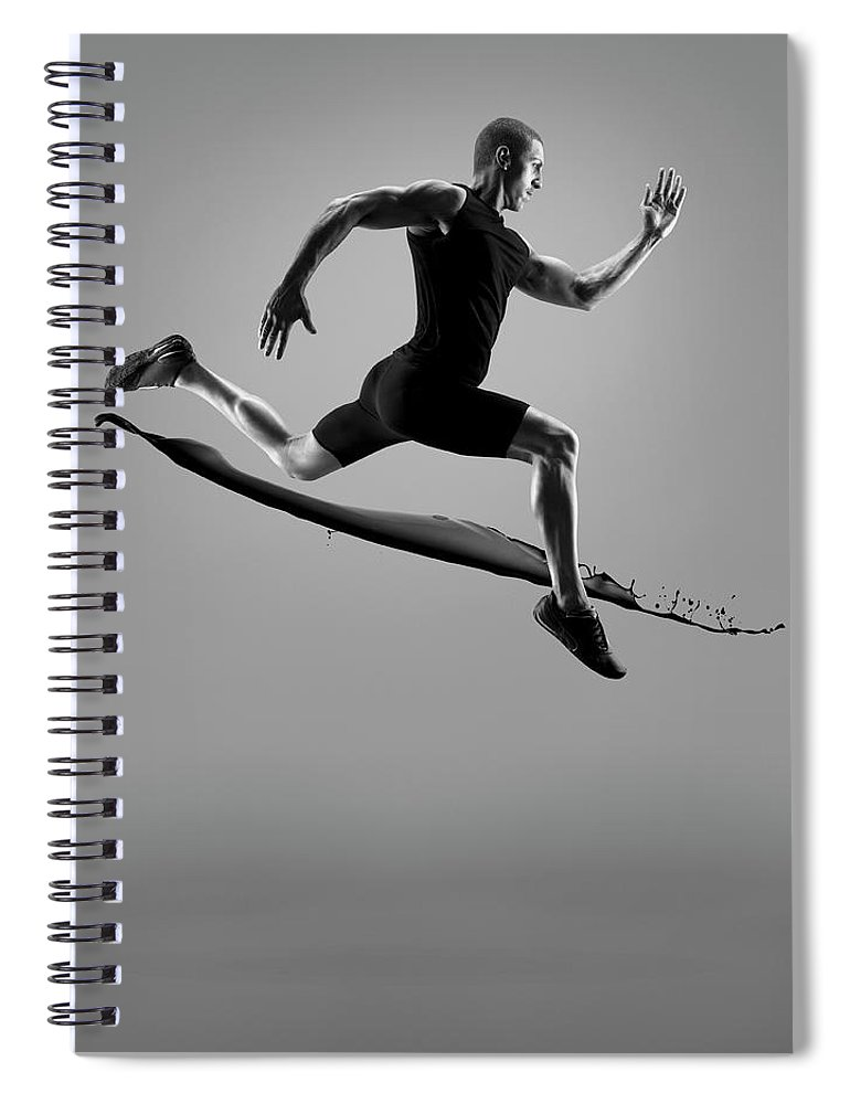 People Spiral Notebook featuring the photograph Male Athlete Running Above Liquid Splash by Jonathan Knowles