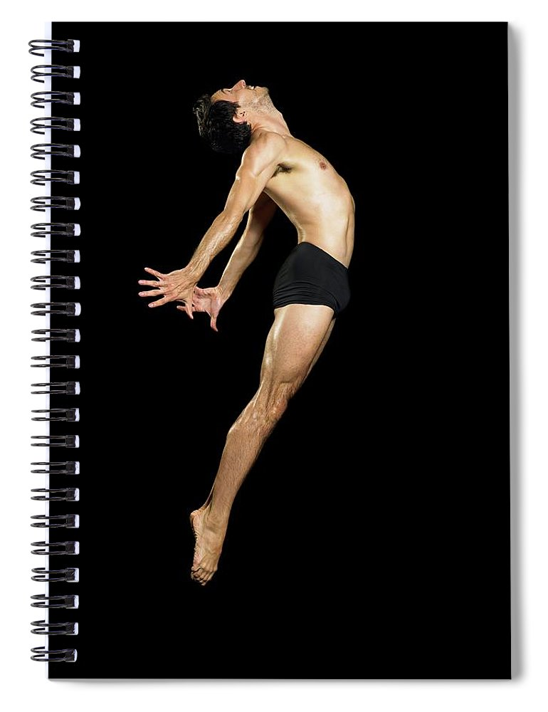 Human Arm Spiral Notebook featuring the photograph Male Dancer Jumping by Image Source