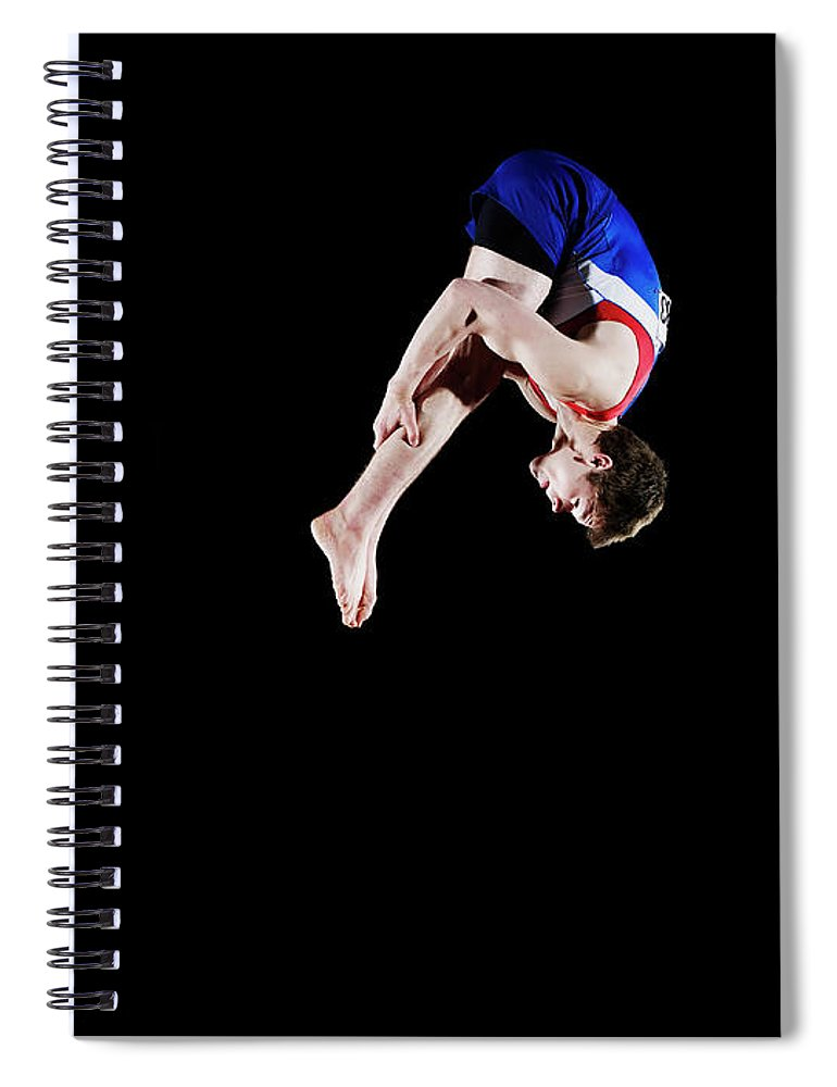 Focus Spiral Notebook featuring the photograph Male Gymnast 16-17 Mid Air, Black by Thomas Barwick