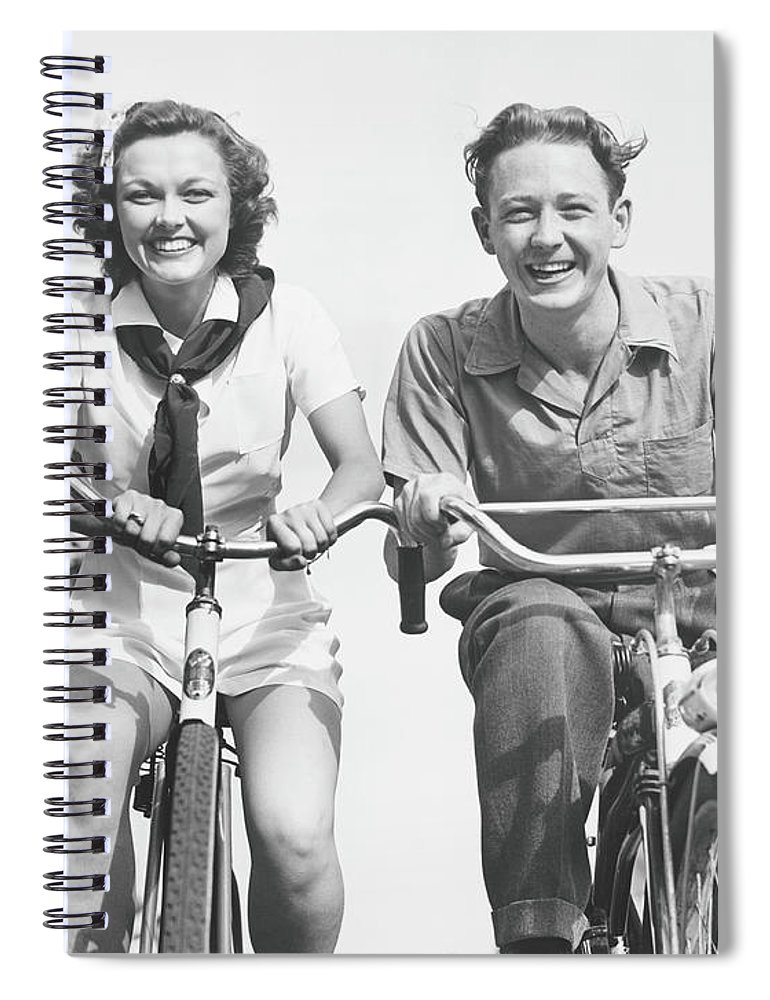 Young Men Spiral Notebook featuring the photograph Man And Woman Riding Bikes, B&w, Low by George Marks