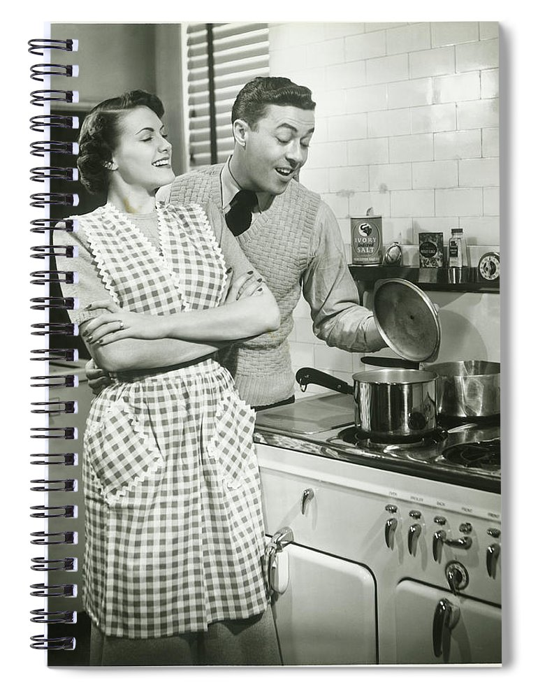 Heterosexual Couple Spiral Notebook featuring the photograph Man Looking Into Pot In Domestic by George Marks