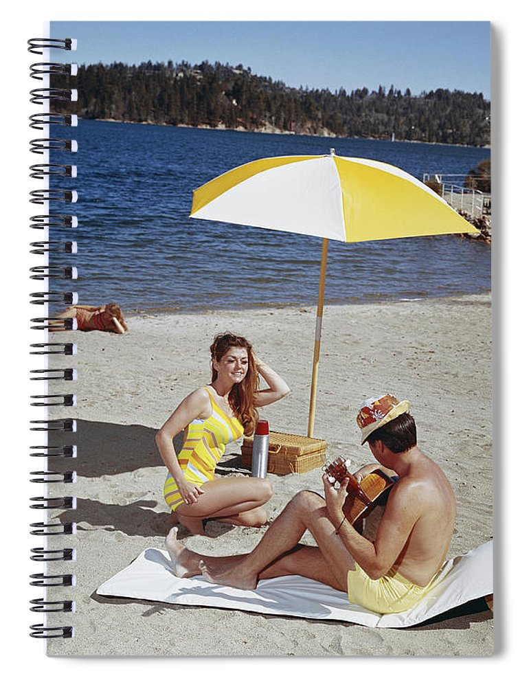 People Spiral Notebook featuring the photograph Man Playing Guitar While Woman Dancing by Tom Kelley Archive