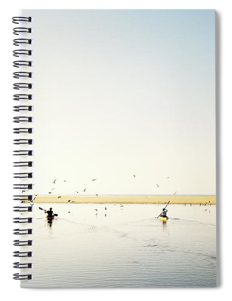 People Spiral Notebook featuring the photograph Men Paddling Kayaks To The Beach by Julien Capmeil