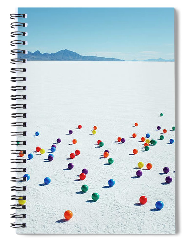 Out Of Context Spiral Notebook featuring the photograph Multi-colored Balls On Salt Flats by Andy Ryan