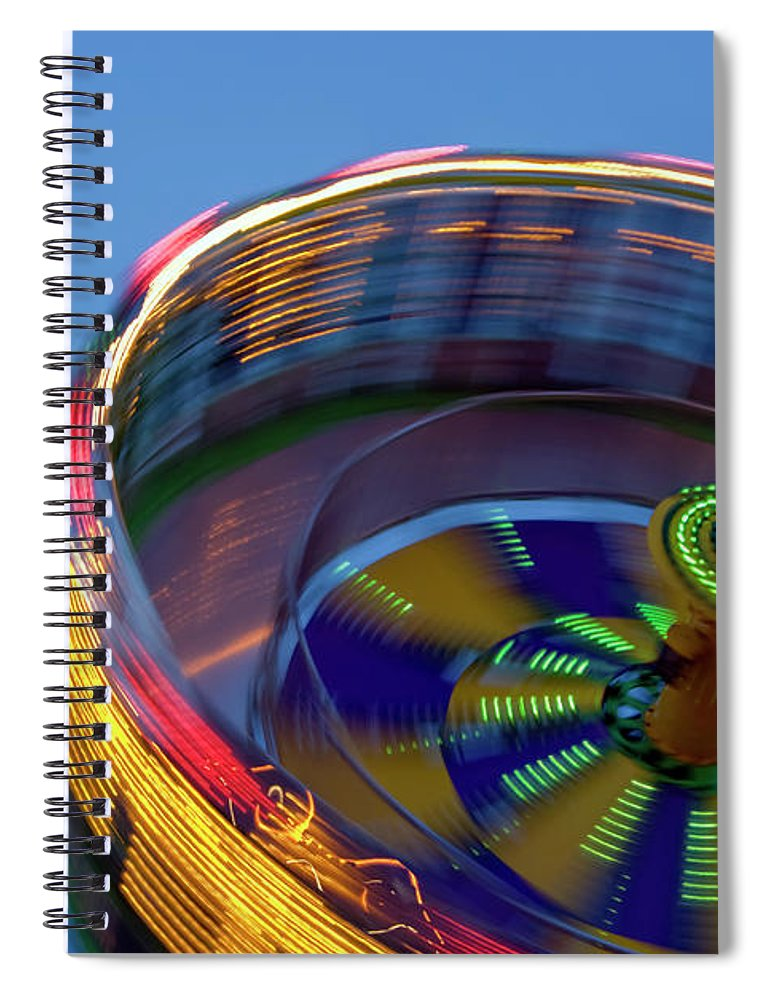 Carousel Spiral Notebook featuring the photograph Multicolored Spinning Carnival Ride by By Ken Ilio