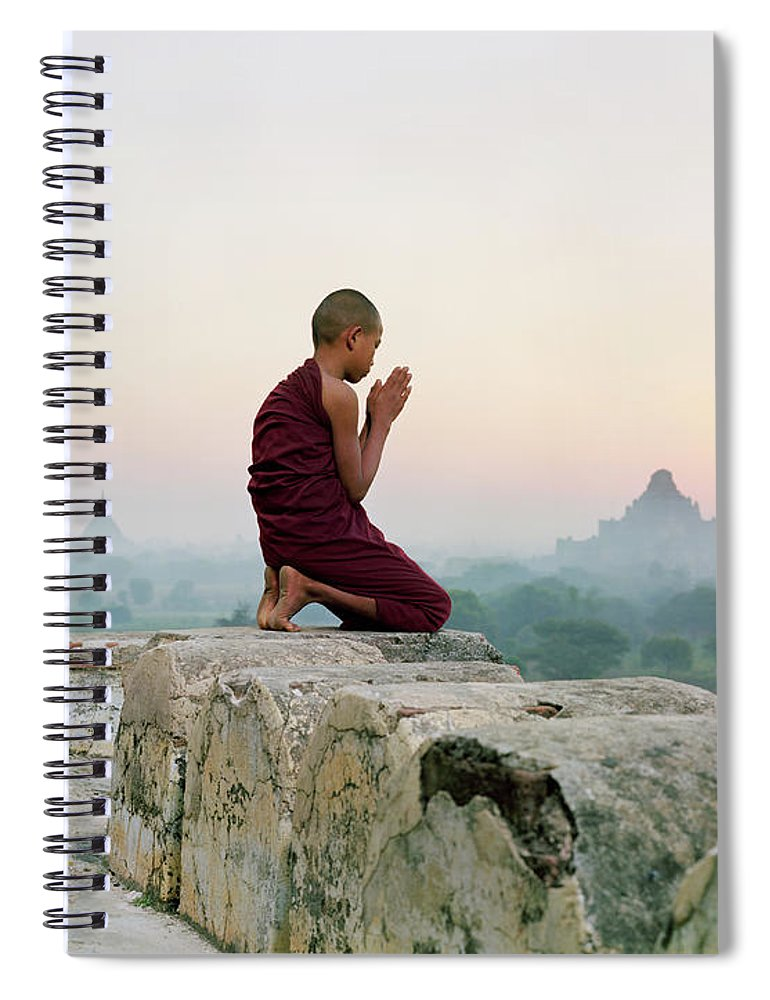 Child Spiral Notebook featuring the photograph Myanmar, Bagan, Buddhist Monk Praying by Martin Puddy