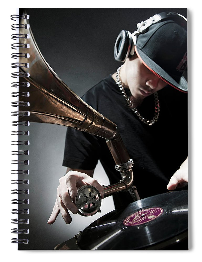 Youth Culture Spiral Notebook featuring the photograph Oriental Dj Using Old Gramophone To Mix by Justin Lambert