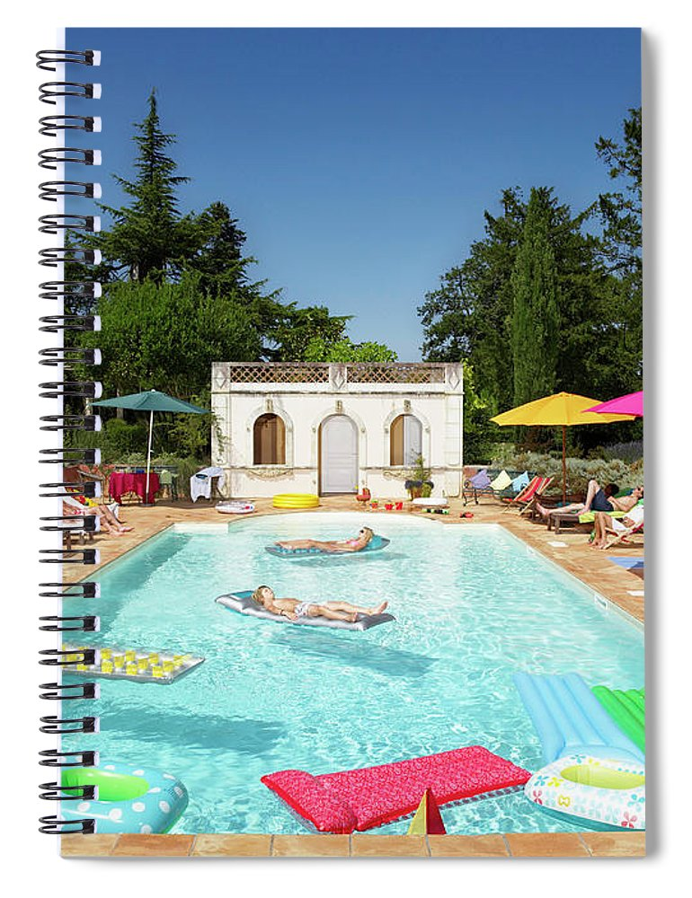 Young Men Spiral Notebook featuring the photograph People Enjoying Summer Around The Pool by Ghislain & Marie David De Lossy