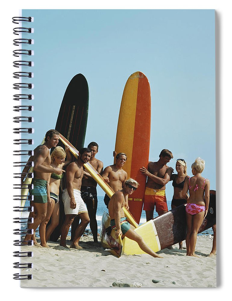 People Spiral Notebook featuring the photograph People On Beach With Surf Board by Tom Kelley Archive