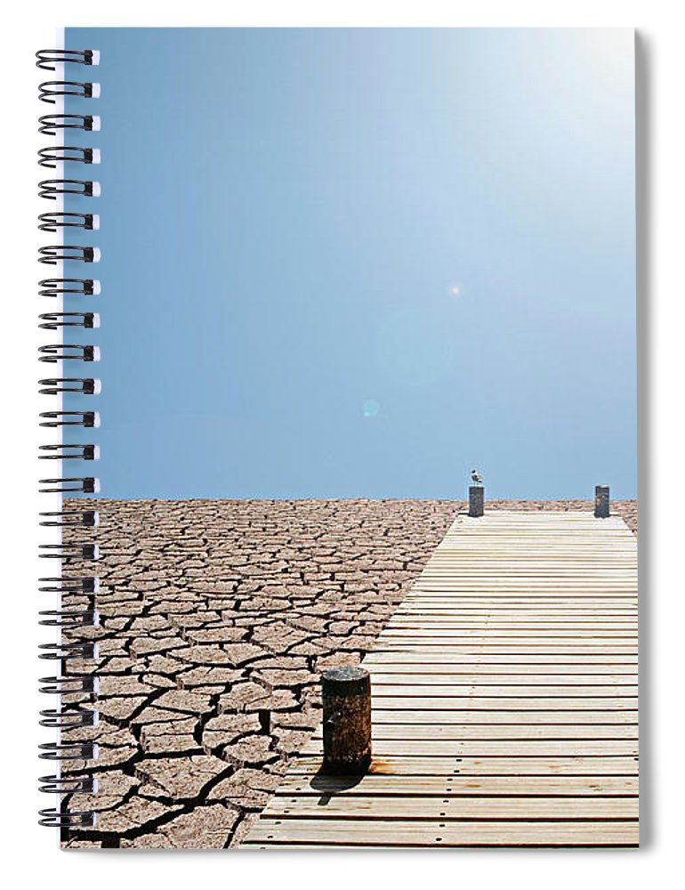 Environmental Damage Spiral Notebook featuring the photograph Pier Over A Dry Lake Bed by John Lund