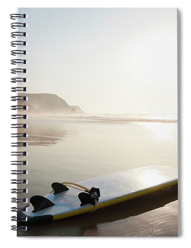 Algarve Spiral Notebook featuring the photograph Portugal, Surfboard On Beach by Westend61
