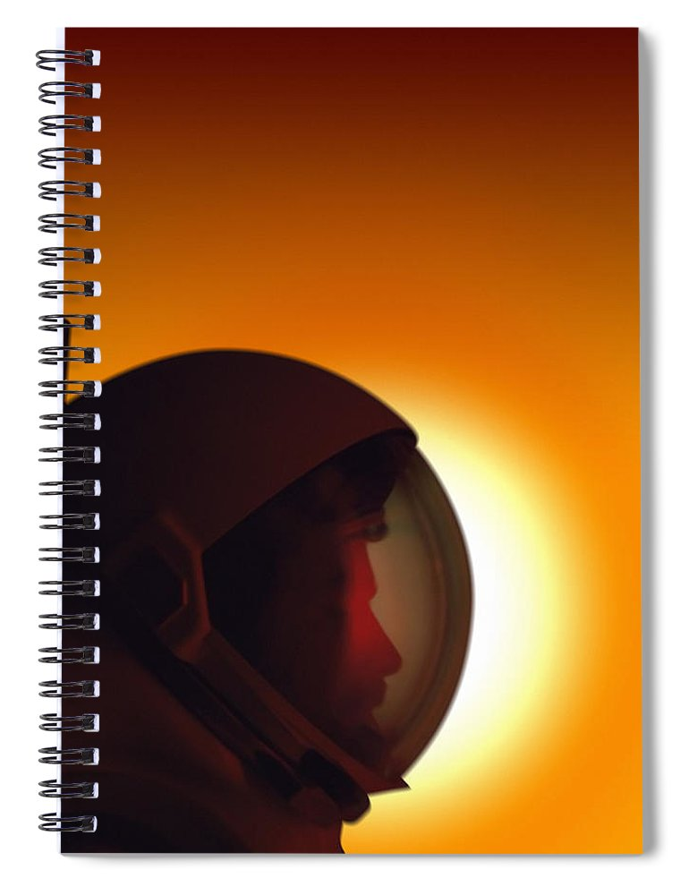 Orange Color Spiral Notebook featuring the photograph Profile Of A Helmeted Astronaut Against by Photodisc