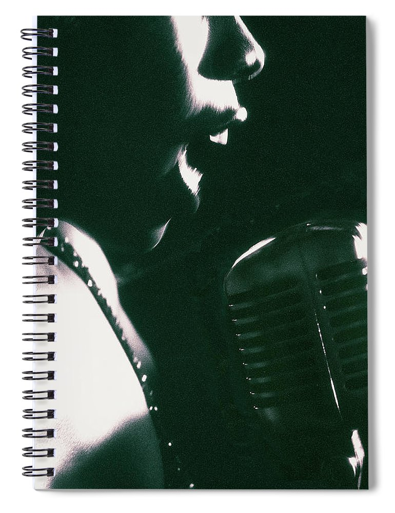 Singer Spiral Notebook featuring the photograph Profile Of Woman Singing Into Microphone by Digital Vision.