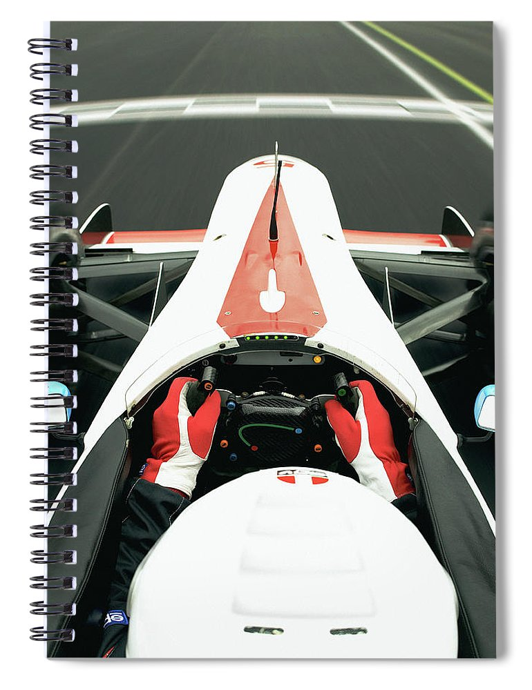 Aerodynamic Spiral Notebook featuring the photograph Racing Driver Approaching Finishing by Alan Thornton