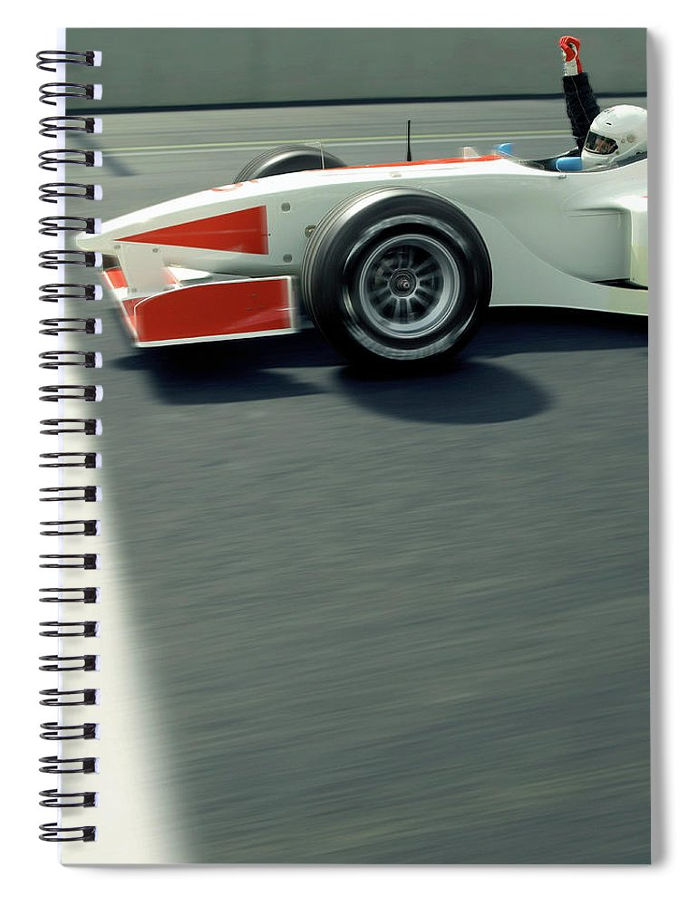 Aerodynamic Spiral Notebook featuring the photograph Racing Driver Crossing Finishing Line by Alan Thornton