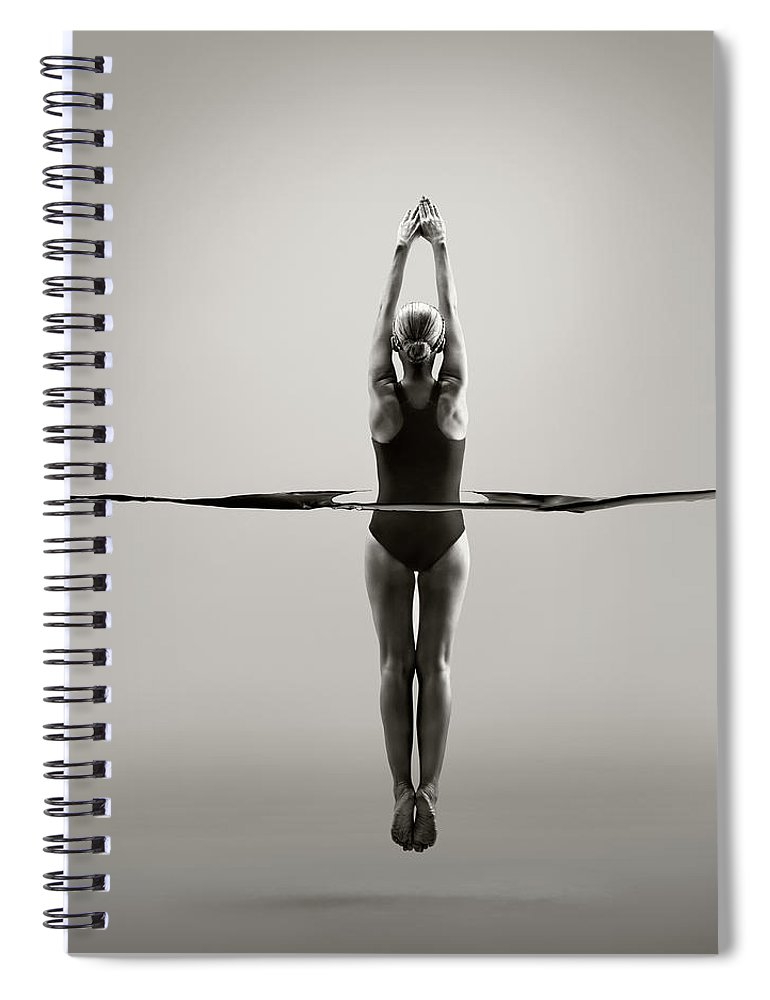 Diving Into Water Spiral Notebook featuring the photograph Rear View Of Female Swimmer by Jonathan Knowles