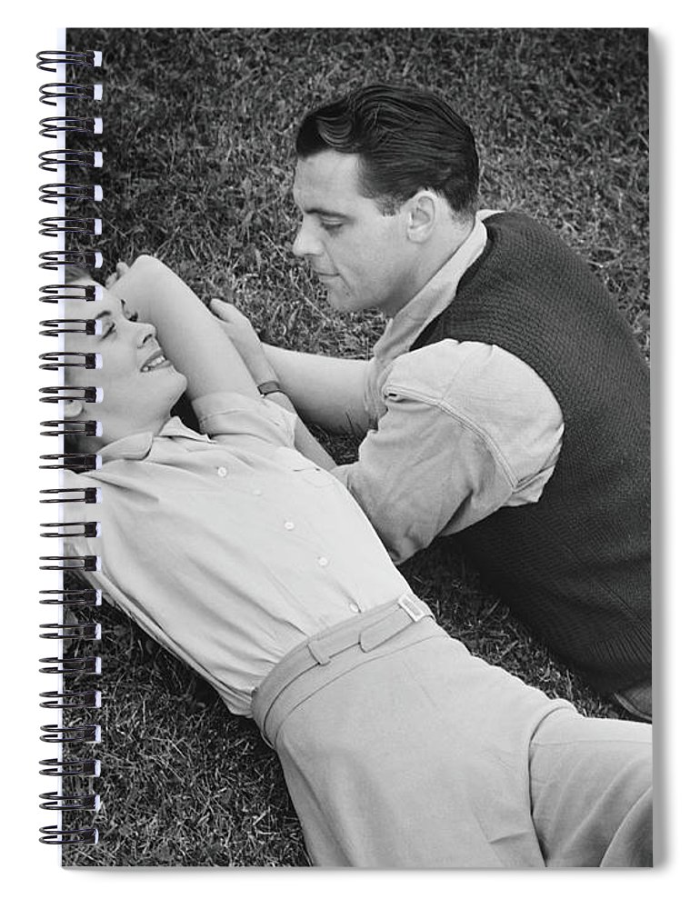 Heterosexual Couple Spiral Notebook featuring the photograph Romantic Couple Lying On Grass, B&w by George Marks