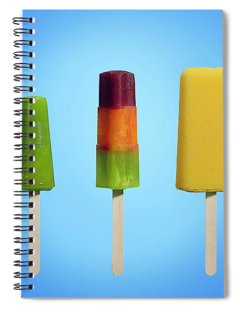In A Row Spiral Notebook featuring the photograph Row Of Different Types Of Ice Cream by Jonathan Knowles