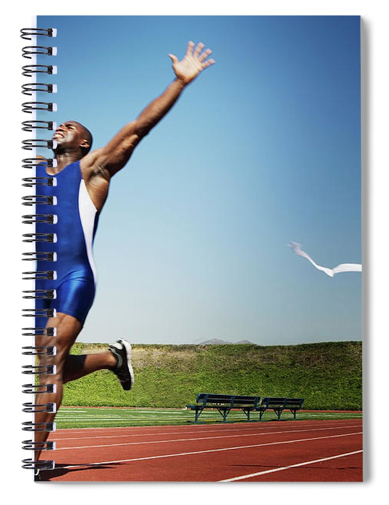Human Arm Spiral Notebook featuring the photograph Runner Crossing Finish Line by Jupiterimages