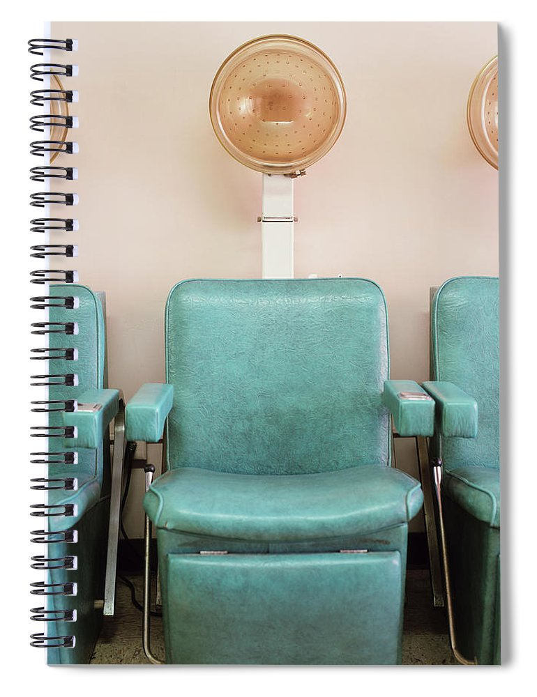 In A Row Spiral Notebook featuring the photograph Salon Hair Dryers by Lisa Romerein