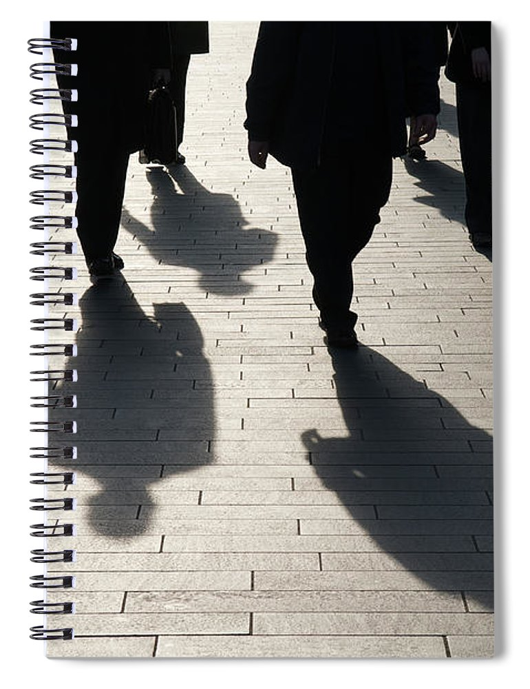 Shadow Spiral Notebook featuring the photograph Shadow Team Of Commuters Walking On by Peskymonkey