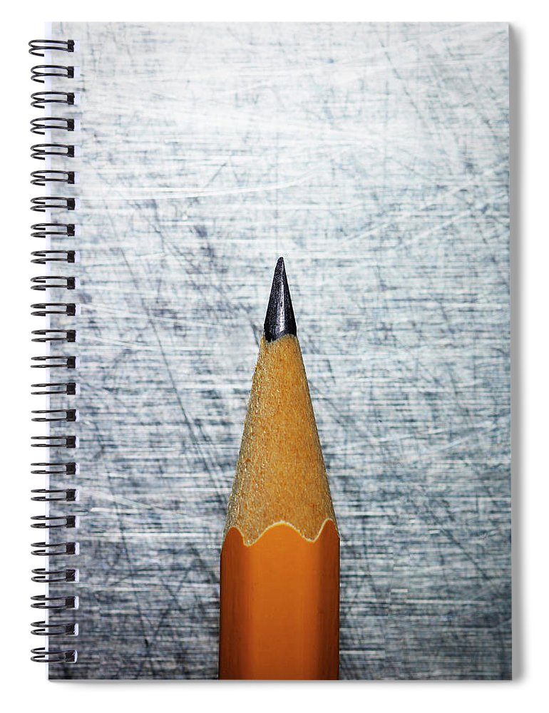 Sharp Spiral Notebook featuring the photograph Sharpened Pencil On Stainless Steel by Ballyscanlon