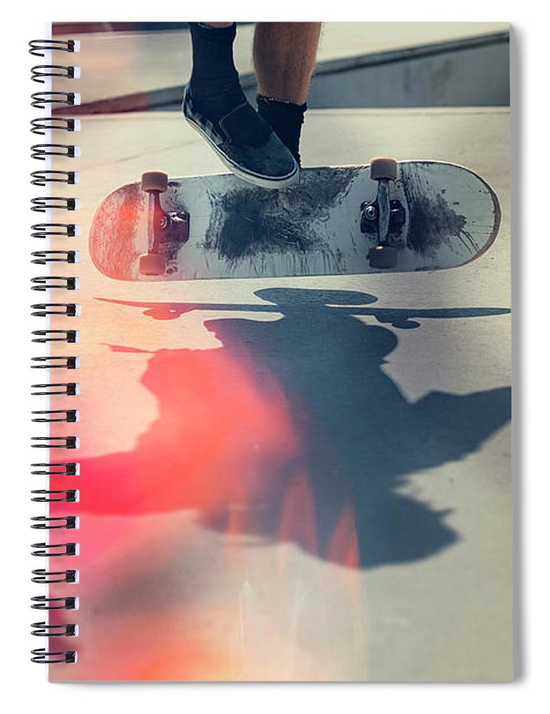 Cool Attitude Spiral Notebook featuring the photograph Skateboarder Doing An Ollie by Devon Strong
