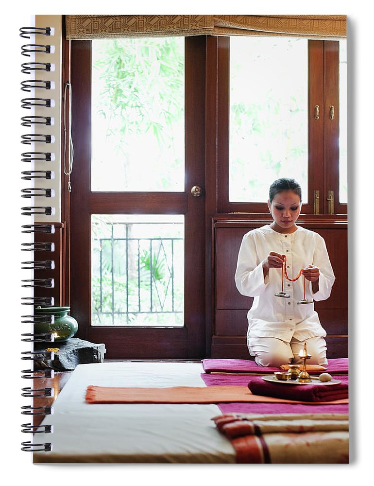 Spa Spiral Notebook featuring the photograph Spa Therapist Prepares Massage Room by Matthew Wakem