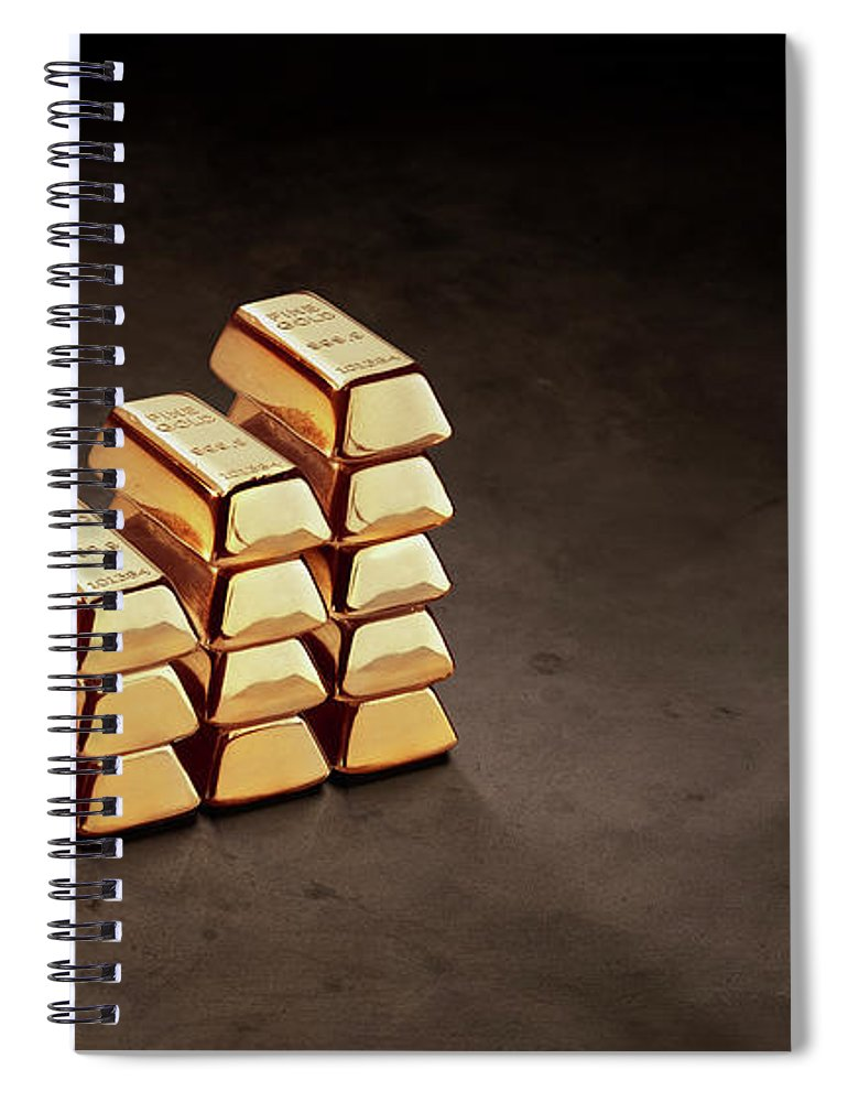In A Row Spiral Notebook featuring the photograph Stepped Stack Of Gold On Dark Surface by Anthony Bradshaw