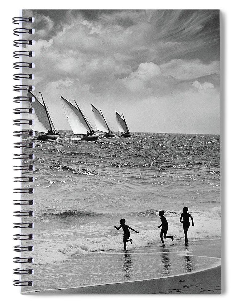Following Spiral Notebook featuring the photograph Three Boys Running Along Beach by Stockbyte