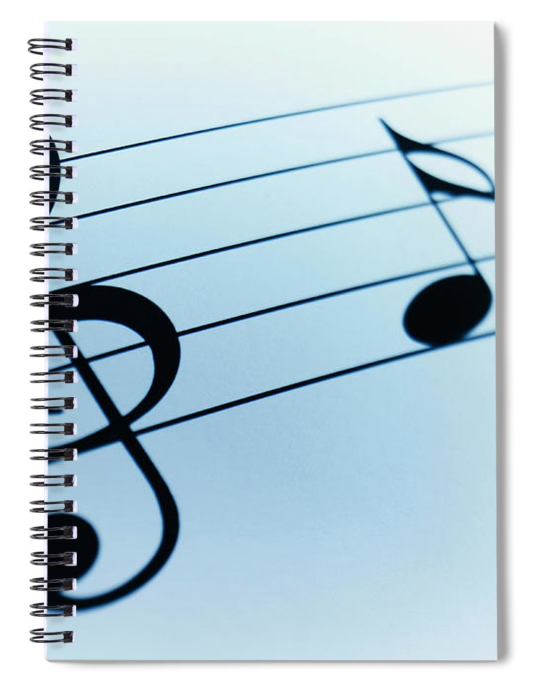 Sheet Music Spiral Notebook featuring the photograph Treble Clef And Notes by Adam Gault
