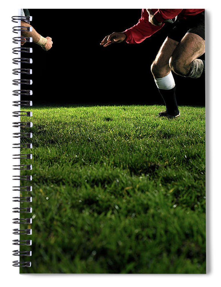 Grass Spiral Notebook featuring the photograph Two Opposing Rugby Players, One Holding by Thomas Barwick
