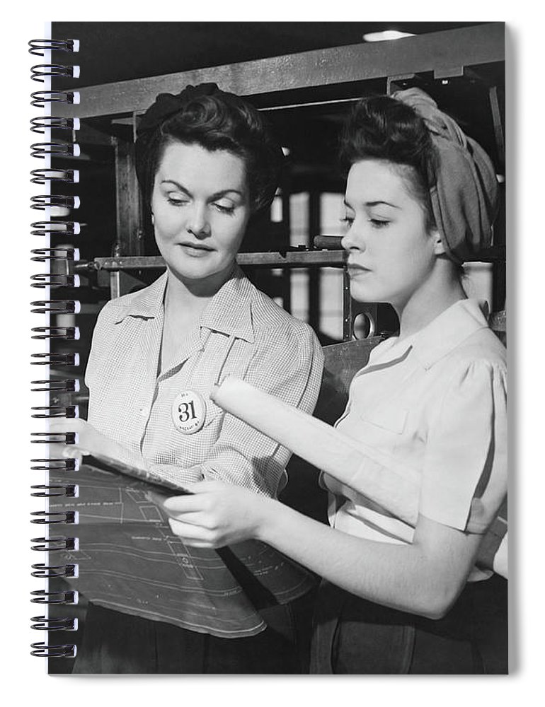 Plan Spiral Notebook featuring the photograph Two Women In Workshop Looking At by George Marks