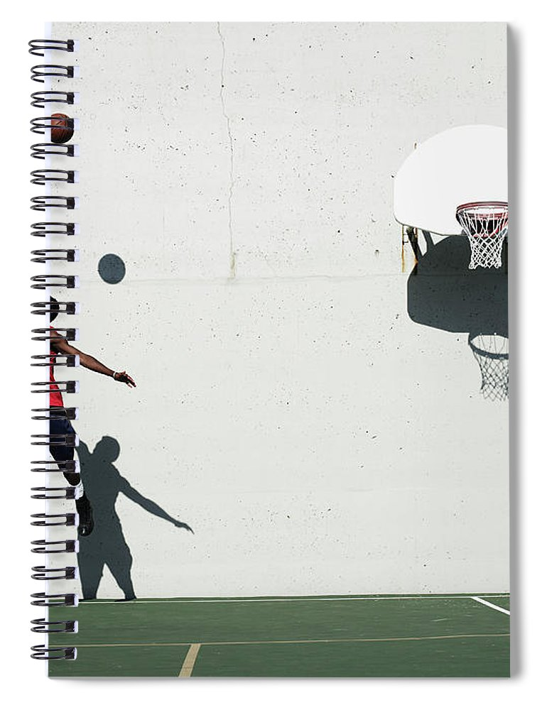 Young Men Spiral Notebook featuring the photograph Two Young Men Playing Basketball by Thomas Barwick