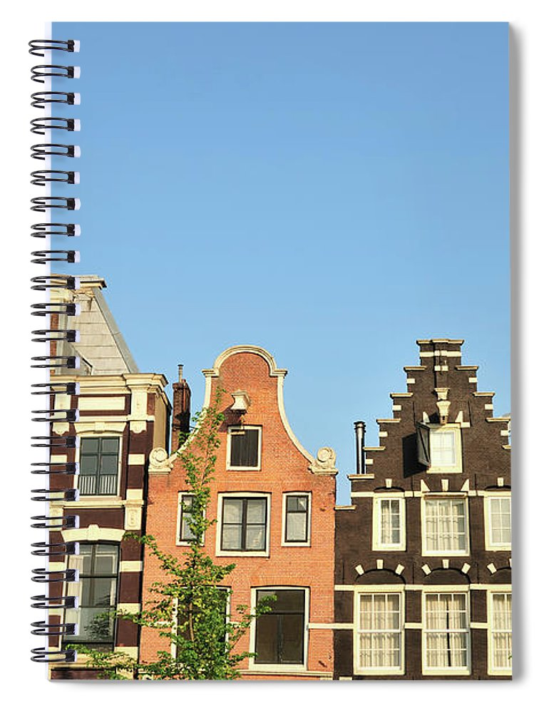 In A Row Spiral Notebook featuring the photograph Typical Canal Houses, Amsterdam, The by Gorazdbertalanic