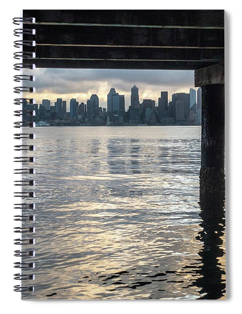 Dawn Spiral Notebook featuring the photograph View Of Downtown Seattle At Sunset From Under A Pier by PorqueNo Studios